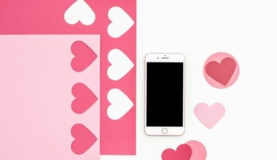 Hearts and Love notes next to mobile phone