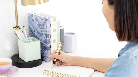 Woman writing in notebook SOAP Bible study