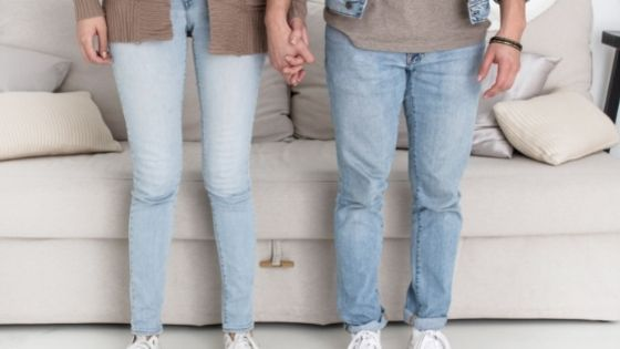 Couple standing holding hands