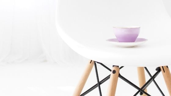 Cup of tea on a white chair
